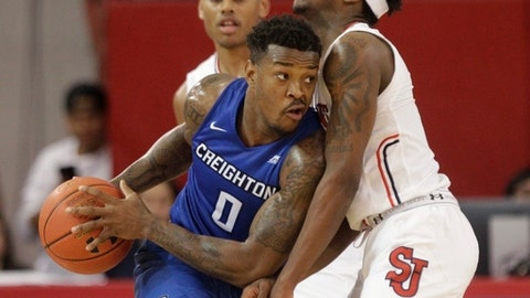 St. John's Shamorie Ponds, right, defends Creighton's Marcus Foster (0) during the second half of an NCAA college basketball game, Wednesday, Jan. 4, 2017, in New York. Creighton won 85-72. (AP Photo/Frank Franklin II)
