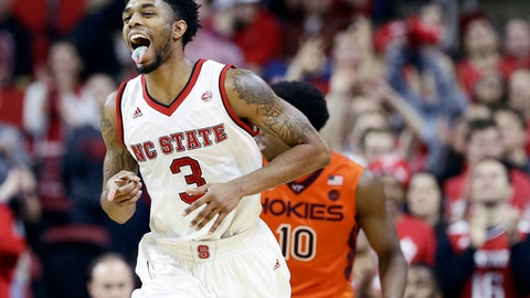 North Carolina State's Terry Henderson (3) reacts following a basket against Virginia Tech during the second half of an NCAA college basketball game in Raleigh, N.C., Wednesday, Jan. 4, 2017. North Carolina State won 104-78. (AP Photo/Gerry Broome)