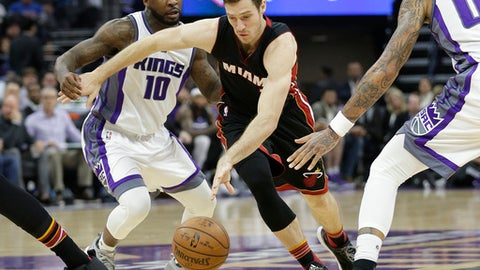 Miami Heat guard Goran Dragic, center, drives between Sacramento Kings Ty Lawson, left, and Willie Cauley-Stein during the first half of an NBA basketball game Wednesday, Jan. 4, 2017, in Sacramento, Calif. (AP Photo/Rich Pedroncelli)