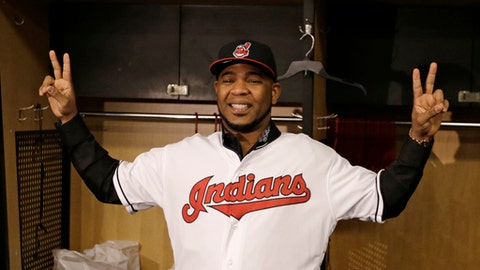 Cleveland Indians' Edwin Encarnacion smiles wearing a Cleveland Indians baseball jersey, Thursday, Jan. 5, 2017, in Cleveland. One win from a World Series title last season, the Indians finalized a $65 million, three-year contract with free agent slugger Encarnacion. (AP Photo/Tony Dejak)