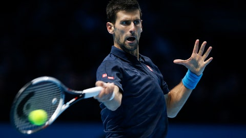 Novak Djokovic of Serbia plays a return to Andy Murray of Britain during their ATP World Tour Finals singles final tennis match at the O2 Arena in London, Sunday, Nov. 20, 2016. (AP Photo/Alastair Grant)