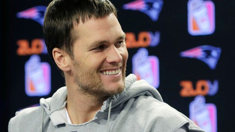 New England Patriots quarterback Tom Brady smiles while taking questions from reporters before a scheduled NFL football practice, Thursday, Jan. 5, 2017, in Foxborough, Mass. (AP Photo/Steven Senne)