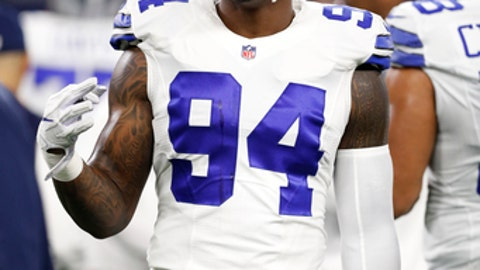 FILE - In this Monday, Dec. 26, 2016 file photo, Dallas Cowboys' Randy Gregory participates in warm ups before an NFL football game against the Detroit Lions in Arlington, Texas. Dallas Cowboys defensive end Randy Gregory has been suspended for at least a year for another violation of the NFL's substance-abuse policy. The suspension announced Thursday, Jan. 5, 2017 makes him ineligible for the playoffs, which start Jan. 15 for Dallas, the top seed in the NFC.(AP Photo/Brandon Wade, File)