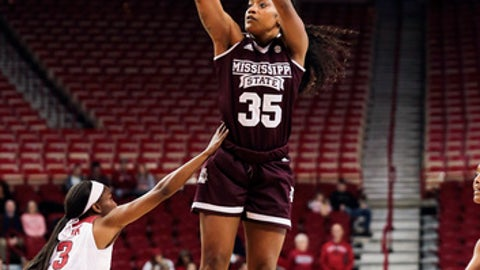 Mississippi State forward Victoria Vivians (35), right, shoots over Arkansas guard Malica Monk (3), left, during the during the first half of an NCAA college basketball game Thursday, Jan. 5, 2017, in Fayetteville, Ark. (AP Photo/Chris Brashers)