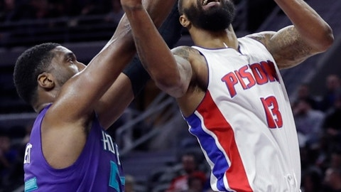 Detroit Pistons forward Marcus Morris (13), defended by Charlotte Hornets center Roy Hibbert (55), shoots during the first half of an NBA basketball game, Thursday, Jan. 5, 2017, in Auburn Hills, Mich. (AP Photo/Carlos Osorio)