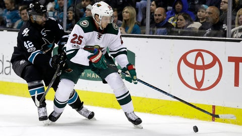 Minnesota Wild's Jonas Brodin (25) is pursued by San Jose Sharks' Joel Ward (42) during the first period of an NHL hockey game Thursday, Jan. 5, 2017, in San Jose, Calif. (AP Photo/Marcio Jose Sanchez)