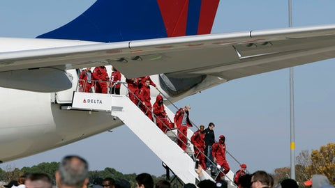 Members of University of Alabama football team deplane after arriving at Tampa International Airport Friday, Jan. 6, 2017, in Tampa, Fla. Alabama takes on Clemson Monday in the College Football Playoff championship game(AP Photo/Chris O'Meara)