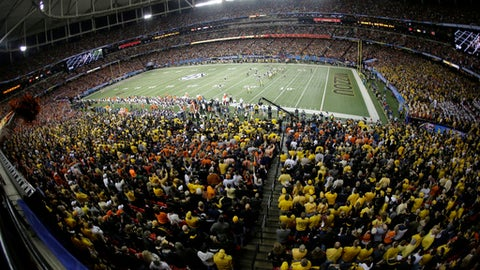 FILE - In this Dec. 7, 2013, file photo, Missouri plays Auburn during the second half of the Southeastern Conference NCAA  college football championship game in Atlanta. The Georgia Dome, which in 1992 became the Atlanta Falcons' home, also has been home to Georgia State football, high school state championships, Peach Bowls and SEC championship games, two Super Bowls and three Final Fours, will make way for the new Mercedes Benz Stadium. (AP Photo/John Bazemore, File)