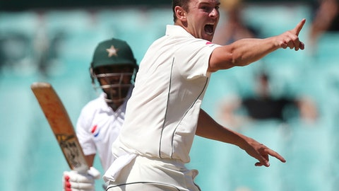 Australia's Josh Hazlewood, right, appeals for the wicket of Pakistan's Babar Azam, left, who is given out lbw during their cricket test match in Sydney, Australia, Saturday, Jan. 7, 2017. (AP Photo/Rick Rycroft)