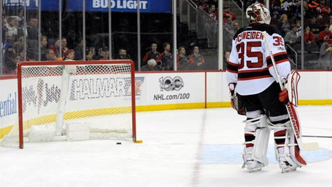 New Jersey Devils goaltender Cory Schneider looks to the bench before he is replaced by Keith Kinkaid after the Toronto Maple Leafs scored three goals during the first period of an NHL hockey game Friday, Jan. 6, 2017, in Newark, N.J. (AP Photo/Bill Kostroun)