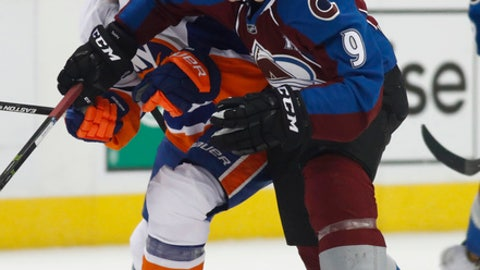 New York Islanders defenseman Thomas Hickey, left, is checked by Colorado Avalanche center Matt Duchene as they pursue the puck in the second period of an NHL hockey game Friday, Jan. 6, 2017, in Denver. (AP Photo/David Zalubowski)