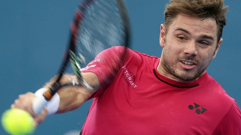 Stan Wawrinka of Switzerland plays a shot in his semi final match against Kei Nishikori of Japan at the Brisbane International tennis tournament in Brisbane, Australia, Saturday,  Jan. 7, 2017. (AP Photo/Tertius Pickard)