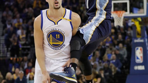 Memphis Grizzlies' Mike Conley, right, is fouled as he shoots by Golden State Warriors' Klay Thompson during the first half of an NBA basketball game Friday, Jan. 6, 2017, in Oakland, Calif. (AP Photo/Marcio Jose Sanchez)