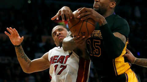 Los Angeles Lakers forward Thomas Robinson (15) rebounds the ball against Miami Heat guard Rodney McGruder (17) during the second half of an NBA basketball game in Los Angeles, Friday, Jan. 6, 2017. The Lakers won 127-100. (AP Photo/Alex Gallardo)