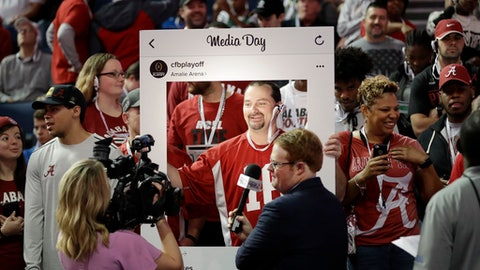 Alabama fan Mike Owen poses for a picture during media day for the NCAA college football playoff championship game between Alabama and Clemson Saturday, Jan. 7, 2017, in Tampa, Fla. (AP Photo/David J. Phillip)