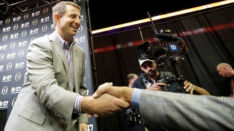 Clemson head coach Dabo Swinney shakes hands during media day for the NCAA college football playoff championship game against Alabama Saturday, Jan. 7, 2017, in Tampa, Fla. (AP Photo/David J. Phillip)