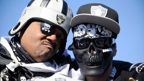 Oakland Raiders fans pose for a photo before the first half of an AFC Wild Card NFL football game between the Houston Texans and the Oakland Raiders, Saturday, Jan. 7, 2017, in Houston. (AP Photo/Eric Christian Smith)