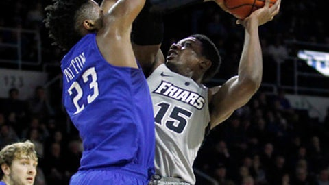 Providence's Emmitt Holt (15) scores as Creighton's Justin Patton (23) defends during the first half of an NCAA college basketball game Saturday, Jan. 7, 2017, in Providence, R.I. (AP Photo/Stew Milne)