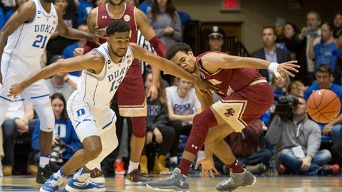 Duke's Matt Jones (13) and Boston College's Jerome Robinson, right, chase after a loose ball during the first half of an NCAA college basketball game in Durham, N.C., Saturday, Jan. 7, 2017. (AP Photo/Ben McKeown)
