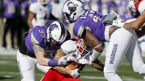 James Madison linebacker Gage Steele (33) and defensive lineman Darrious Carter (47) stop Youngstown State running back Jody Webb (20) at the line of scrimmage on a carry in the first half of the FCS championship NCAA college football game, Saturday, Jan. 7, 2017, in Frisco, Texas. (AP Photo/Tony Gutierrez)