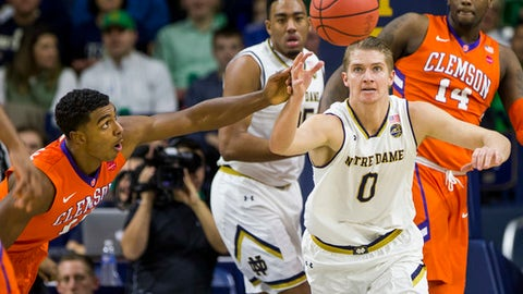 Notre Dame's Rex Pflueger (0) chases down a loose ball next to Clemson's Donte Grantham, left, during the first half of an NCAA college basketball game Saturday, Jan. 7, 2017, in South Bend, Ind. (AP Photo/Robert Franklin)