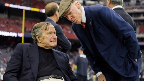 Former president George H.W. Bush talks with Houston Texans owner Bob McNair before the first half of an AFC Wild Card NFL game between the Houston Texans and the Oakland Raiders, Saturday, Jan. 7, 2017, in Houston. (AP Photo/Eric Christian Smith)