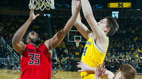 Maryland forward Damonte Dodd (35) and Michigan forward Mark Donnal (34) contest for a rebound in the first half of an NCAA college basketball game at Crisler Center in Ann Arbor, Mich., Saturday, Jan. 7, 2017. (AP Photo/Tony Ding)
