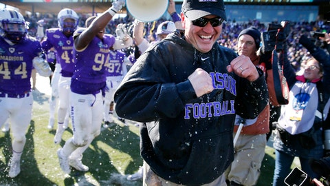 James Madison head coach Mike Houston smiles after being dunked by his team following their 28-14 win against Youngstown State in the FCS championship NCAA college football game, Saturday, Jan. 7, 2017, in Frisco, Texas. (AP Photo/Tony Gutierrez)