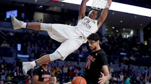 Georgia Tech's Josh Okogie, top, dunks over Louisville's Anas Mahmoud during the second half of an NCAA college basketball game in Atlanta, Saturday, Jan. 7, 2017. Louisville won 65-50. (AP Photo/David Goldman)