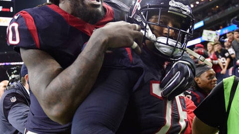 Houston Texans defensive end Jadeveon Clowney jumps on Houston Texans tackle Duane Brown as they leave field during the second half of an AFC Wild Card NFL football game Saturday, Jan. 7, 2017, in Houston. The Houston Texans won 27-14. (AP Photo/Eric Christian Smith)