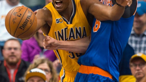 Indiana Pacers center Myles Turner (33) works to regain control of the ball as he is defended under the basket by New York Knicks forward Kristaps Porzingis (6) during the first half of an NBA basketball game, Saturday, Jan. 7, 2017, in Indianapolis. (AP Photo/Doug McSchooler)