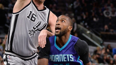 Charlotte Hornets forward Michael Kidd-Gilchrist (14) looks to shoot against San Antonio Spurs center Pau Gasol, of Spain, during the first half of an NBA basketball game, Saturday, Jan. 7, 2017, in San Antonio. (AP Photo/Darren Abate)