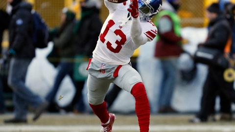 New York Giants wide receiver Odell Beckham (13) warms up before an NFC wild-card NFL football game against the Green Bay Packers, Sunday, Jan. 8, 2017, in Green Bay, Wis. (AP Photo/Matt Ludtke)