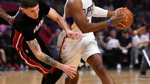 Los Angeles Clippers guard Chris Paul, right, drives pas Miami Heat guard Tyler Johnson during the first half of an NBA basketball game, Sunday, Jan. 8, 2017, in Los Angeles. (AP Photo/Mark J. Terrill)