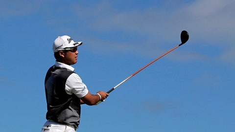 Hideki Matsuyama, of Japan, hits from the 14th tee during the final round of the Tournament of Champions golf event, Sunday, Jan. 8, 2017, at Kapalua Plantation Course in Kapalua, Hawaii. (AP Photo/Matt York)