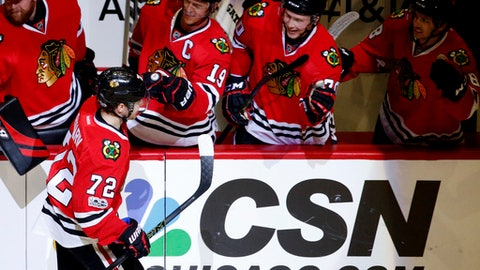 Chicago Blackhawks left wing Artemi Panarin (72) celebrates with teammates after scoring a goal during the first period of an NHL hockey game against the Nashville Predators, Saturday, Jan. 8, 2017, in Chicago. (AP Photo/Nam Y. Huh)