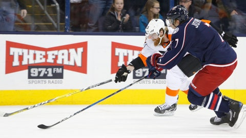 Philadelphia Flyers' Jakub Voracek, left, of the Czech Republic, and Columbus Blue Jackets' Jack Johnson chase the puck during the third period of an NHL hockey game Sunday, Jan. 8, 2017, in Columbus, Ohio. The Blue Jackets beat the Flyers 2-1 in overtime. (AP Photo/Jay LaPrete)
