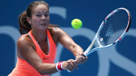 Russia's Daria Kasatkina plays a shot to Angelique Kerber of Germany during their women's singles match at the Sydney International tennis tournament in Sydney, Australia, Tuesday, Jan. 10, 2017. (AP Photo/Rick Rycroft)