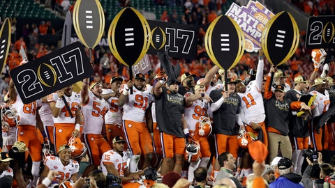 Clemson players celebrate after the NCAA college football playoff championship game against Alabama Tuesday, Jan. 10, 2017, in Tampa, Fla. Clemson won 35-31. (AP Photo/Chris O'Meara)