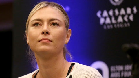 FILE - In this Monday, Oct. 10, 2016 file photo, Maria Sharapova speaks to members of the media prior to a World Team Tennis exhibition in Las Vegas, U.S. Sharapova will return from her 15-month doping ban at a tournament in Germany in April. (AP Photo/Isaac Brekken, file)
