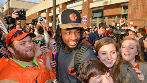 Clemson's Mike Williams poses for photos with fans Tuesday, Jan. 10, 2017, in Clemson, S.C., the day after the Tigers defeated Alabama 35-31 in the College Football Playoff championship NCAA college football game in Tampa. (AP Photo/Richard Shiro)