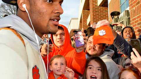 Young fans react as Clemson's Deshaun Watson returns, Tuesday, Jan. 10, 2017, in Clemson, S.C., the day after the Tigers defeated Alabama 35-31 in the College Football Playoff championship NCAA college football game in Tampa, Fla. (AP Photo/Richard Shiro)