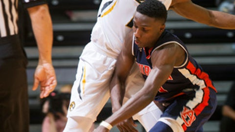 Missouri's Terrence Phillips, left, fouls Auburn's Jared Harper, right, as he dribbles the ball up court during the first half of an NCAA college basketball game Tuesday, Jan. 10, 2017, in Columbia, Mo. (AP Photo/L.G. Patterson)