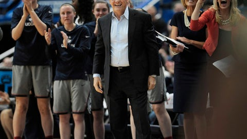 Connecticut head coach Geno Auriemma, center, and his team reacts in the first half of an NCAA college basketball game against South Florida, Tuesday, Jan. 10, 2017, in Hartford, Conn. (AP Photo/Jessica Hill)