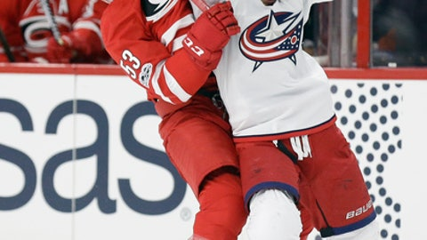 Carolina Hurricanes' Jeff Skinner (53) and Columbus Blue Jackets' Cam Atkinson struggle for possession of the puck during the second period of an NHL hockey game in Raleigh, N.C., Tuesday, Jan. 10, 2017. (AP Photo/Gerry Broome)