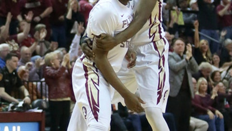Florida State's P.J. Savoy gets a hug from teammate Terance Mann after hitting a three-pointer against Duke in the first half of an NCAA college basketball game, Tuesday, Jan. 10, 2017, in Tallahassee, Fla. (AP Photo/Steve Cannon)