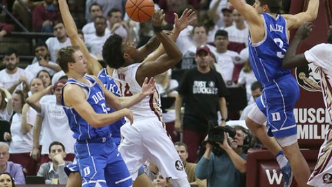 Florida State's Terance Mann attempts a shot against Duke's Grayson Allen, right, and Luke Kennard in the first half of an NCAA college basketball game, Tuesday, Jan. 10, 2017, in Tallahassee, Fla. (AP Photo/Steve Cannon)