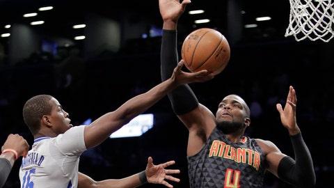 Atlanta Hawks' Paul Millsap (4) defends Brooklyn Nets' Isaiah Whitehead (15) during the first half of an NBA basketball game Tuesday, Jan. 10, 2017, in New York. (AP Photo/Frank Franklin II)