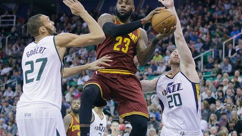 Cleveland Cavaliers forward LeBron James (23) passes the ball as Utah Jazz's Rudy Gobert (27) and Gordon Hayward (20) defend in the first half during an NBA basketball game Tuesday, Jan. 10, 2017, in Salt Lake City. (AP Photo/Rick Bowmer)