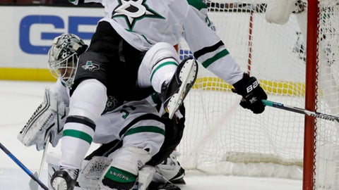 Dallas Stars right wing Adam Cracknell, top, falls over goalie Antti Niemi during the second period of an NHL hockey game against the Anaheim Ducks in Anaheim, Calif., Tuesday, Jan. 10, 2017. (AP Photo/Chris Carlson)